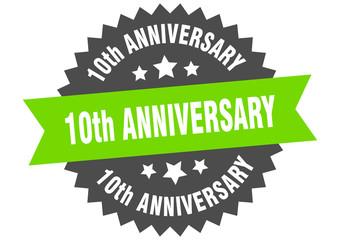 10th anniversary sign. 10th anniversary green-black circular band label