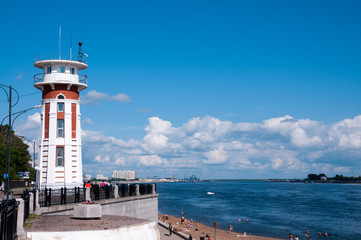 Russia, Blagoveshchensk, July 2019: Decorative tower-the lighthouse and the beach of the Amur river in summer, in the city of Blagoveshchensk