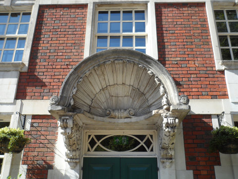Carved Stone Clam Shell Canopy over Doorway