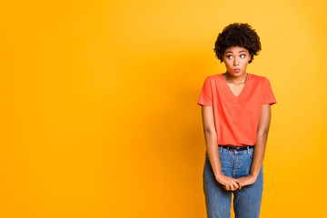 Copyspace photo of cute charming pretty girlfriend unconfident standing hesitating to ask something wearing jeans denim isolated over yellow vivid color background