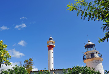 New and old lighthouse of El Rompido in the coast of Huelva, Andalusia, Spain