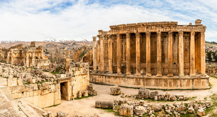 Poster Bedehuis Ancient Roman temple of Bacchus panorama with surrounding ruins and city, Bekaa Valley, Baalbek, Lebanon
