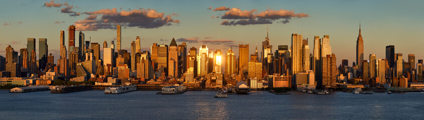 New York City sunset on Midtown West and its skyscrapers. Panoramic view on Manhattan and the Hudson River banks