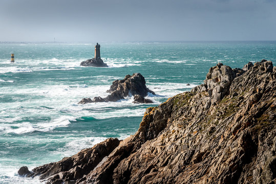 The Pointe du Raz, Brittany. This rocky cape faces the island of Sein. The giant waves of the Atlantic Ocean are shattered on the rocks and at the foot of La Vieille lighthouse.