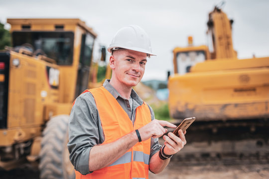 Caucasian engineer using smart phone