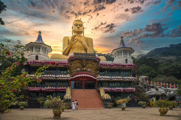 Huge golden Buddha statue on top of the Museum of the Golden Temple Dambulla