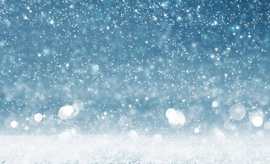 Christmas background with bright lights and snowfall.