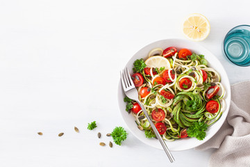 vegan ketogenic spiralized courgette salad with avocado tomato pumpkin seeds