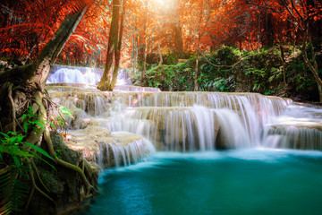 Amazing in nature, beautiful waterfall at colorful autumn forest in fall season Wall mural