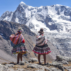 Quechua girls admire Andean mountain views on the Ausungate trail. Cusco, Peru