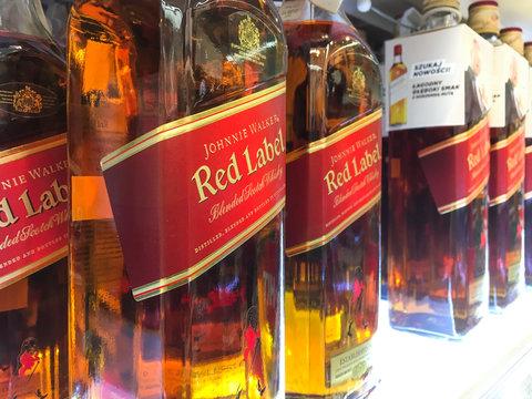 Nowy Sacz, Poland - April 16, 2017: Bottles of Johnnie Walker Scotch whisky on store shelves for sale in Tesco Hypermarket.