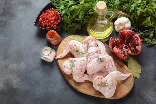 Raw chicken wings with ingredients for cooking