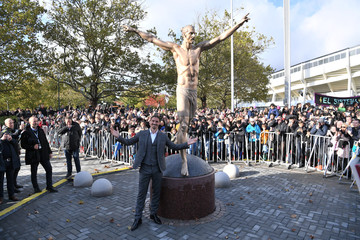 Swedish soccer star Zlatan Ibrahimovic poses in front of a 2,7m bronze statue of him during the unveiling ceremony near Malmo Stadium