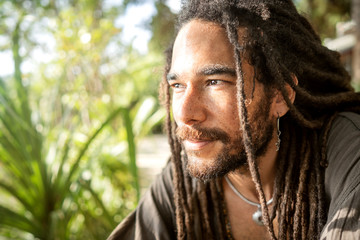 handsome guy with dreadlocks on an island in thailand