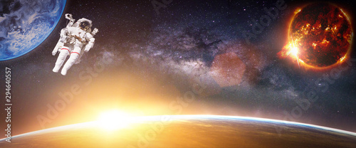 Wall mural Landscape with Milky way galaxy. Sunrise and Earth view from space with Astronaut. (Elements of this image furnished by NASA)