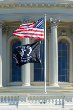 U.S. Capitol dome with U.S. and POW/MIA flags