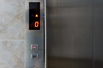Metallic elevator panel with button and led display.  Interior and closeup of metal buttons in elevator