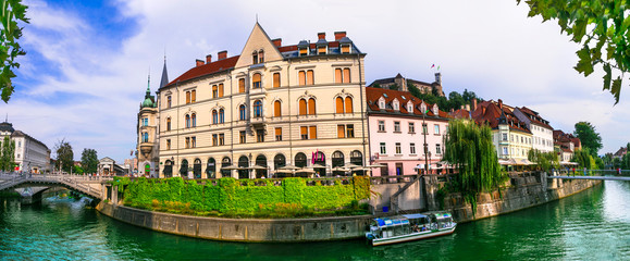 Fototapete - Romantic beautiful Ljubljana city, capital of Slovenia. Urban scene with canals in downtown