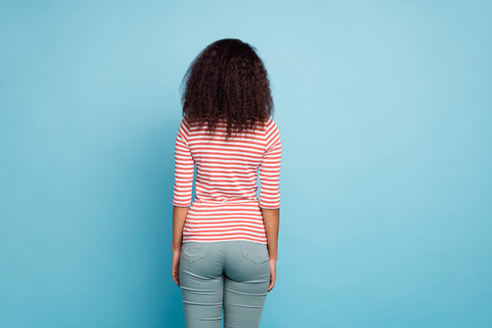 Rear view photo of amazing dark skin lady turned back not showing face offended at boyfriend wear casual street clothes isolated pastel blue color background