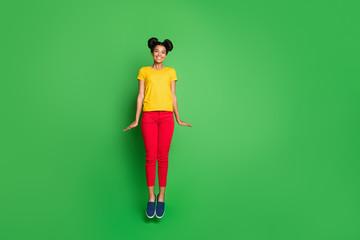 Full body photo of pretty dark skin lady jumping high crazy summer mood wear casual yellow t-shirt...