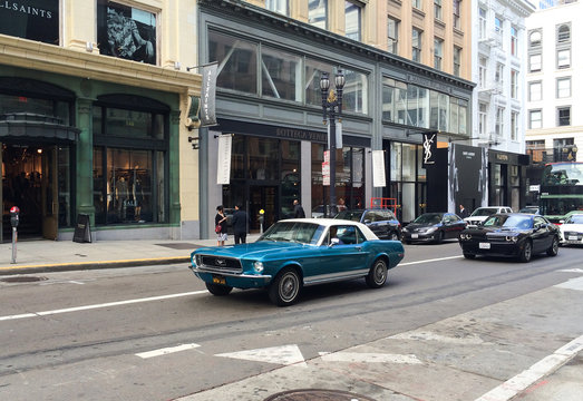 SAN FRANCISCO, USA - June 13, 2015: Man drives the old  Ford Mustang Shelby GT350 in the center of San Francisco.