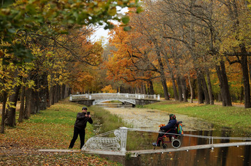 A man takes picture of a woman on a wheelchair in Tsarskoe Selo outside Saint Petersburg
