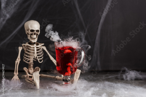 Cocktail Red-Handed-Jill with skeleton and smoke. Halloween drinks