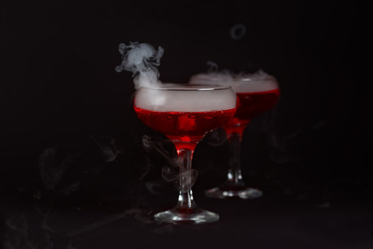 Halloween red cocktail Bloody Mary with smoke