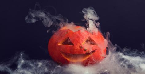 Scary halloween pumpkin head. Scary pumpkin on table. Halloween background