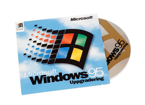 Stockholm, Sweden - December 15, 2014:  Microsoft Windows 95 operating system cover with CD for the Swedish version, isolated on white background.
