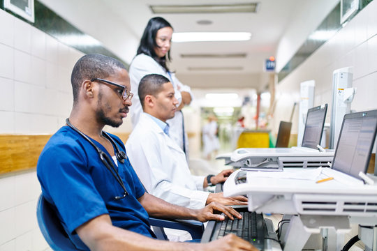 Three doctors doing administrative work
