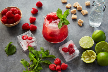 Muddled raspberry margarita on a concrete surface