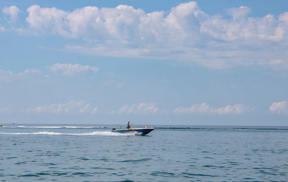 Riding the Black Sea on a boat with a motor on a hot summer day