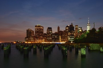 A view of the new york city skyline just after the sun has set.