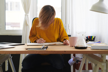 Young woman working on illustration