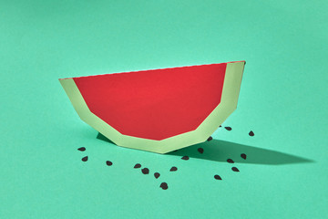 Handcraft paper piece of a healthy watermelon fruit with seeds o
