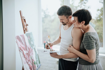 A couple in love in a home art studio