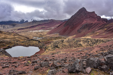 Views of lake Huampococha and red valley from Anta Pass. Ausungate, Cusco, Peru