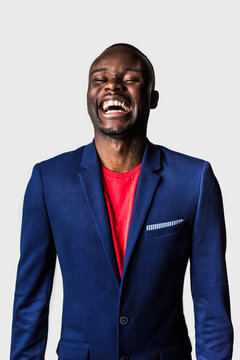 Laughing young man wearing blue suit