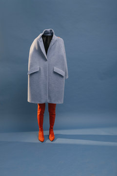 model with blue coat on blue background