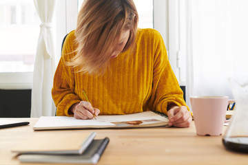 Woman creating graphic sketch