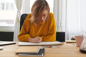 Young woman drawing with inspiration