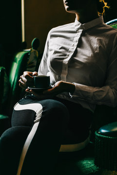 Midsection of woman having coffee