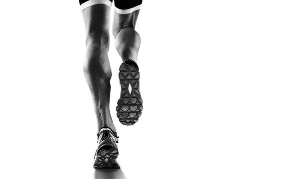 Sports background. Runner feet running closeup on shoe. Isolated on white.