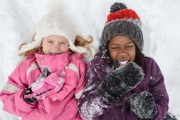 Redhead and Black Girls Laughing in Snow