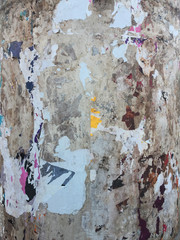 torn posters on old wall
