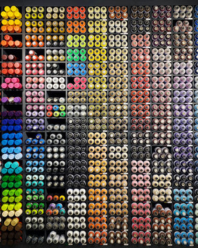 shop for graffiti artists. A lot of multi-colored cans of paint