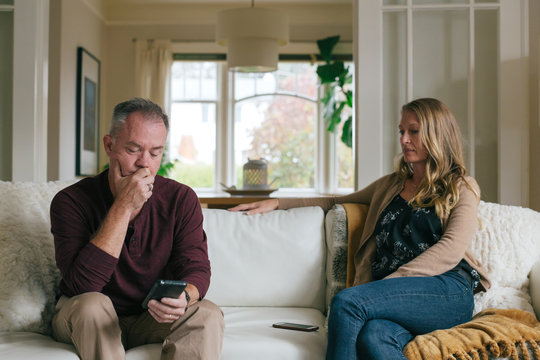 Marriage partners having a difficult conversation at home