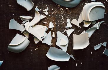 Shards of broken crockery ceramic plates cups and porcelain