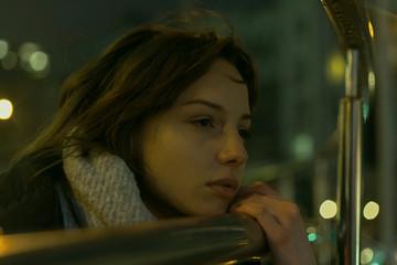 portrait of beautiful gilr on street at night light